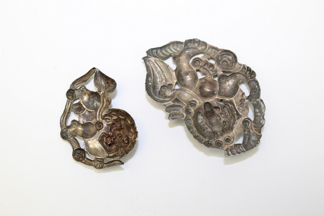Two Chinese silver foo dog pendants - 2