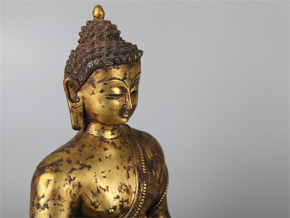 Chinese bronze figure of a Buddha. - 2