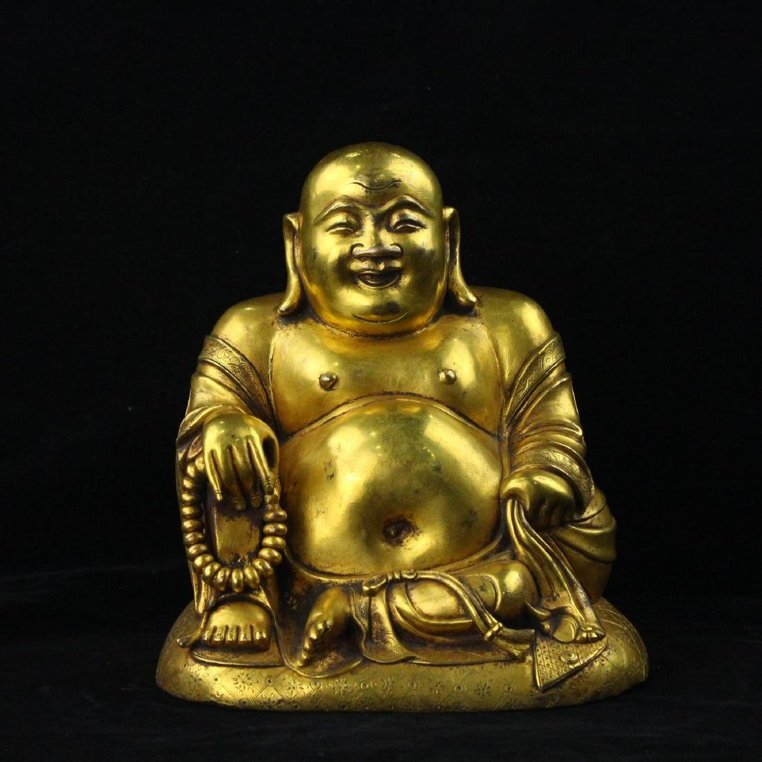 Chinese gilt bronze figure of Laughing Buddha.