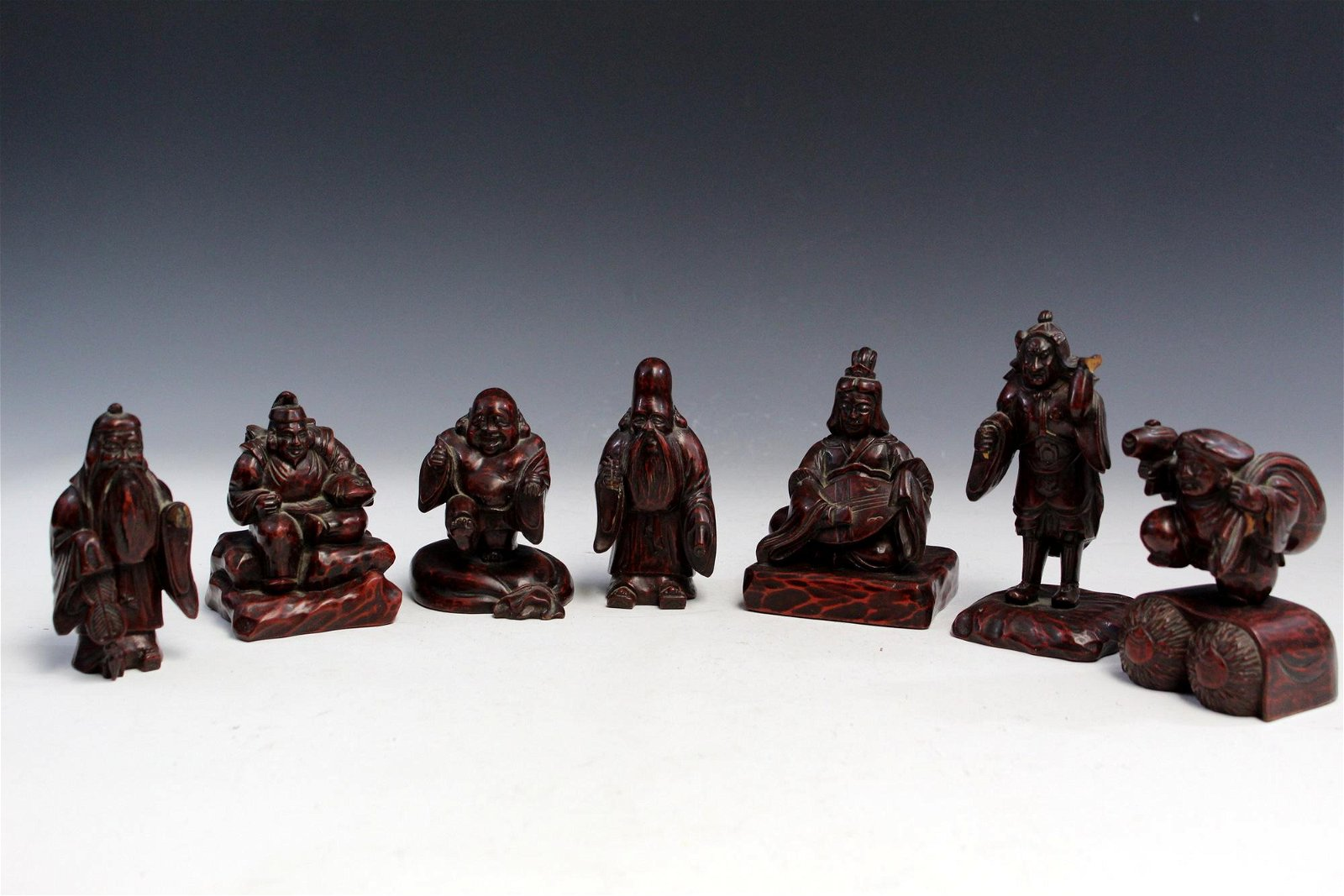 Seven Japanese carved wood figures.