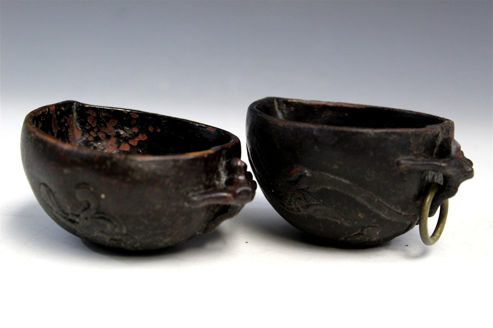 Two Chinese carved peach shaped lacquer brush washers.