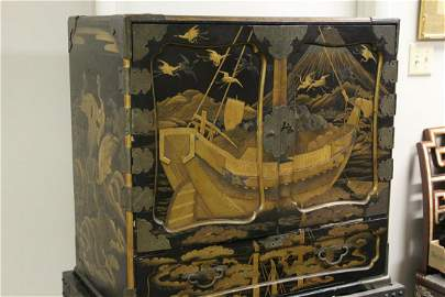 A Japanese Lacquer Cabinet on Wood Stand