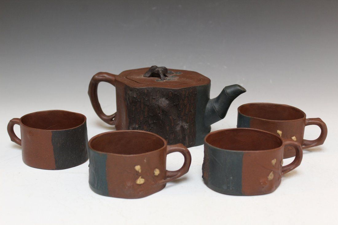 Chinese tea set, including teapot and four cups, mark