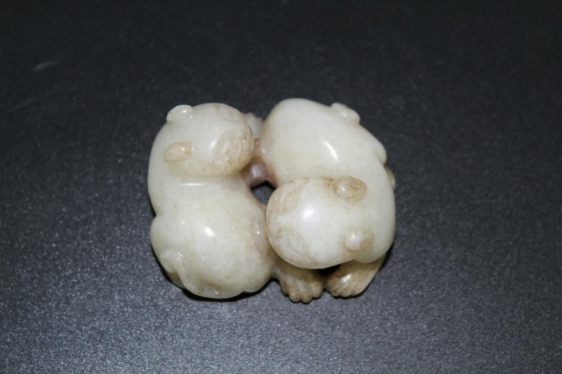 Chinese carved jade of two cats.