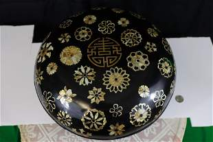 Asian lacquer box with mother of pearl inlaid.