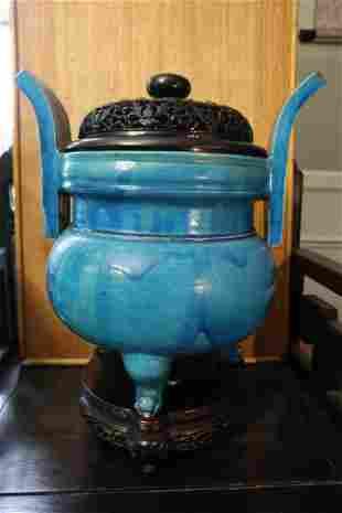 Chinese blue glazed porcelain incense burner on wood