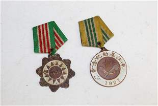 Two Chinese military medals. Dated 1927 and 1927.