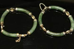A pair of Chinese spinach jade bracelets.