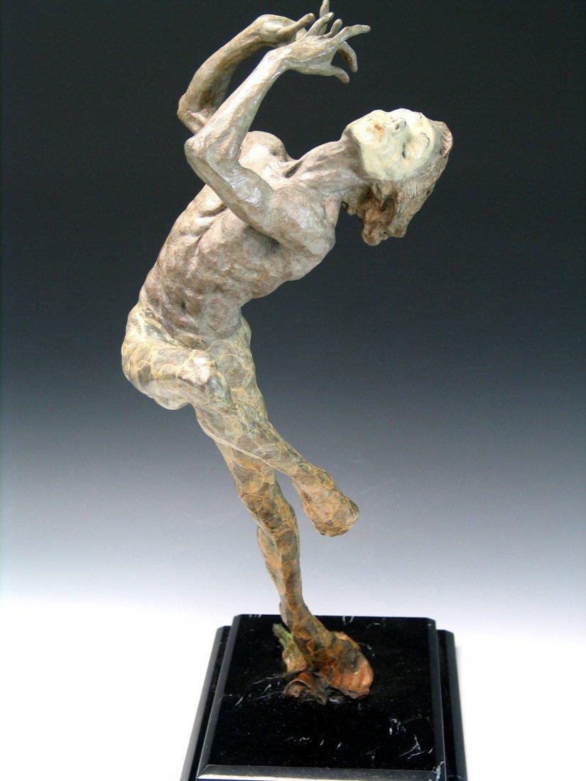 Flutist, Bronze Sculpture, bears the signature of