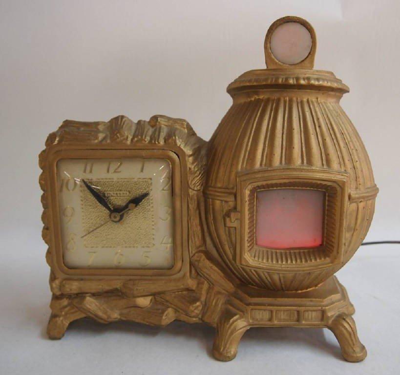 vintage united pot belly stove clock