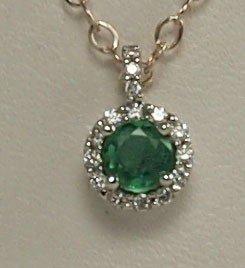24: 14k White Gold Round Emerald Pendant