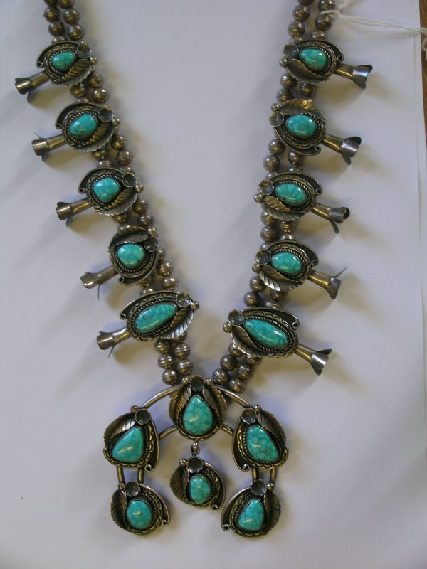 6B: A turquoise and white metal set necklace designed a