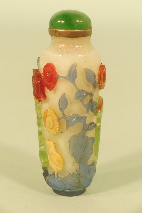 7C: A Chinese four colour overlay glass snuff bottle,