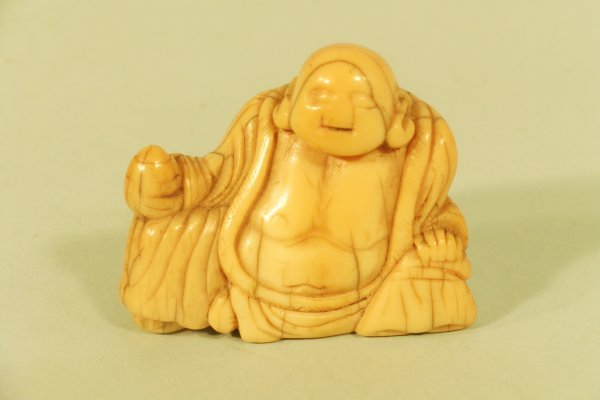 18C: A Japanese carved ivory study of Hotei, 17th/18th