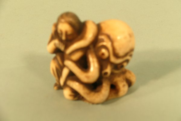 20C: A Japanese carved ivory erotic study of an octopus