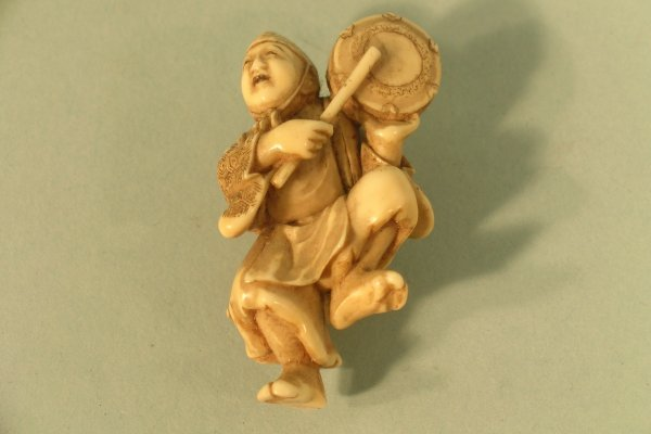 21C: A Japanese carved ivory study of a dancing man bea