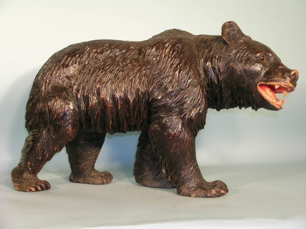 2D: A Black Forest carved and painted model of a bear,