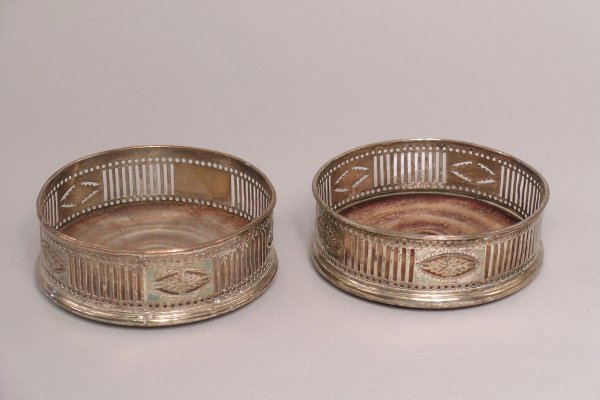 3: A pair of Edwardian silver plated bottle coasters, e