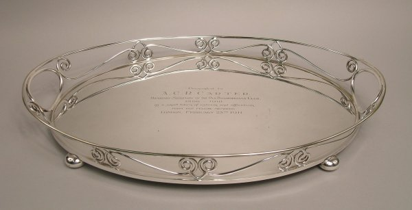 10: A silver plated two-handled oval tray, dated 1911,