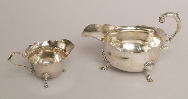 11: A silver sauce boat, London 1749, of squat baluster