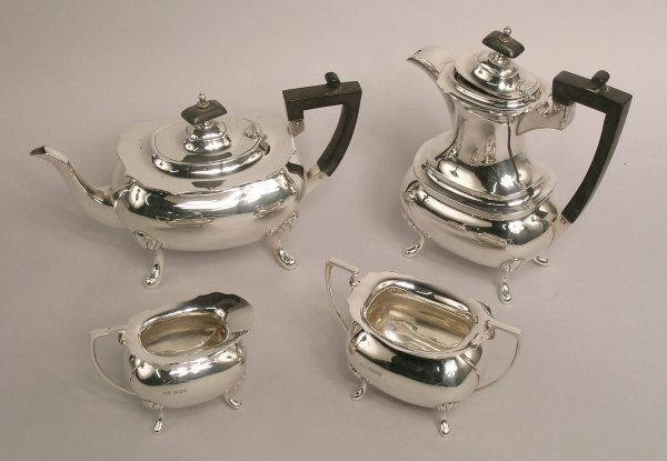 14: A silver four piece tea service, by Walker and Hall