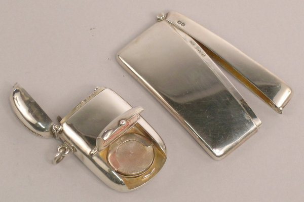 16: A silver card case by WN, Chester 1904, along with