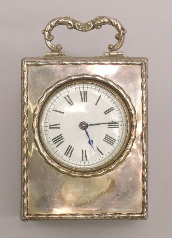 18: A silver fronted key-wound bedside time piece by Sy