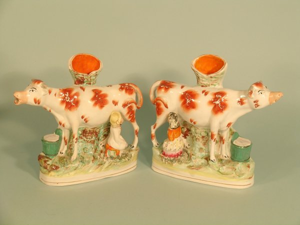 24C: A pair of staffordshire spill vase cow groups circ