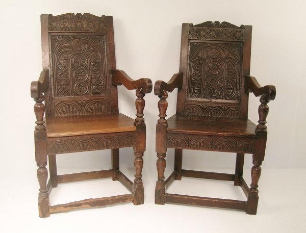 144C: Two panel back open armchairs, constructed using