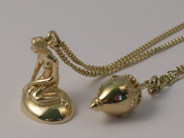 "8C: A mermaid pendant stamped ""585"" Denmark with attach"