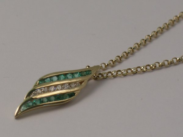 "9C: An emerald and diamond set ""leaf"" pendant all set i"