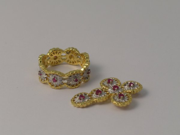 16C: A ruby set cross pendant and a matching ring, with