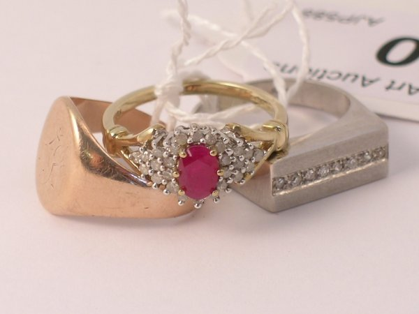 20C: A ruby and diamond cluster ring within plain 9ct g