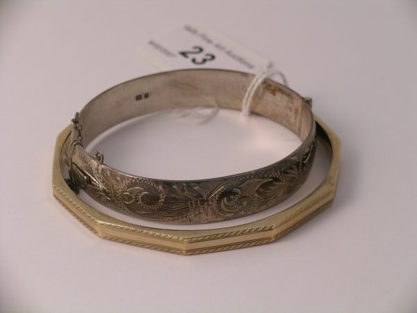 23C: A yellow metal slave bangle with machine engraved