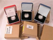 201C: Two silver proof £1 dated 1999, a silver proof pi