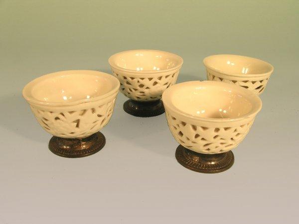 20B: Four Chinese blanc de chine tea bowls, Kangxi (166