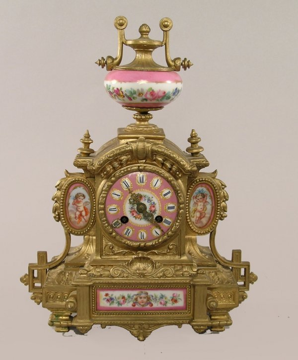 113B: A Louis XVI style mantel clock with Sevres style