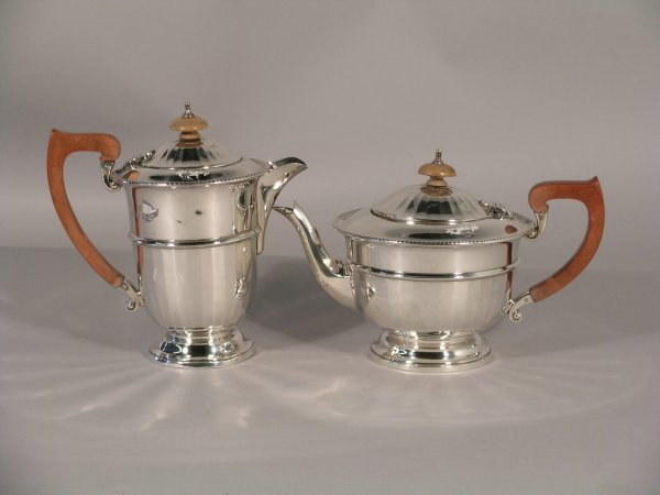 2C: A silver teapot and hot water jug Adie Brothers Bir