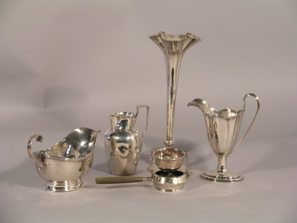 5C: A selection of silver to include; a silver pedestal