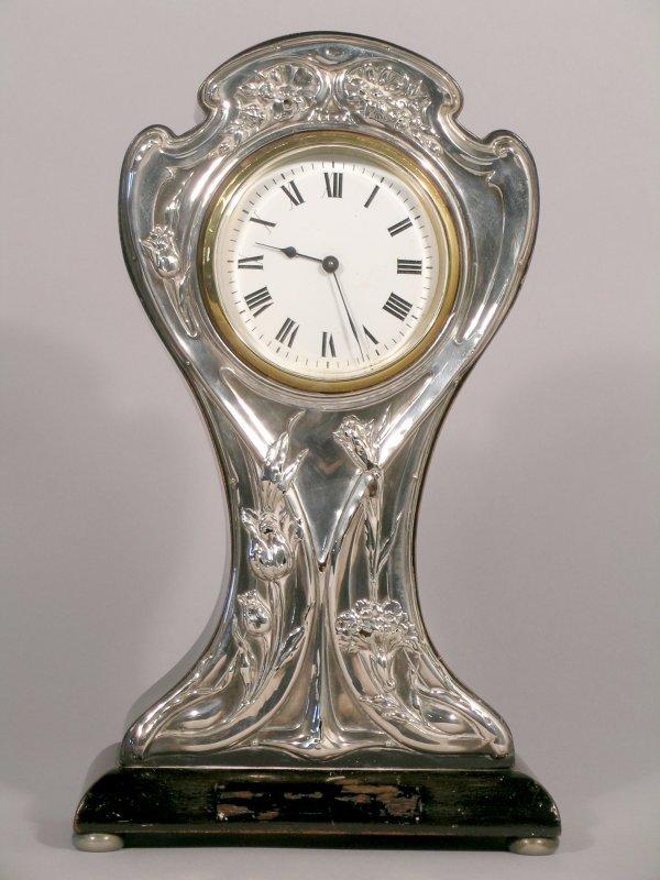 7C: A silver Art Nouveau mantel clock William Devenport