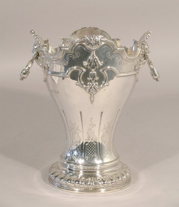 12C: A silver two handled vase in revival style Norther
