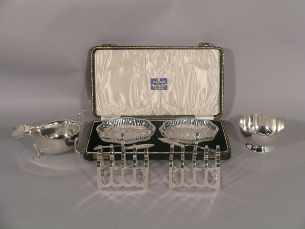 17C: A pair of silver four division toast racks, James