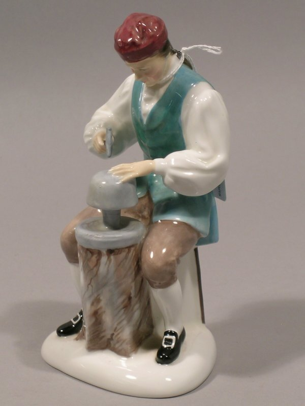 17D: A Royal Doulton figure The Silversmith of Williams
