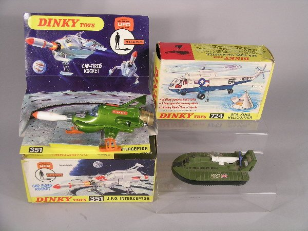 4B: A group of three Dinky toys, an unmarked No 351 UFO