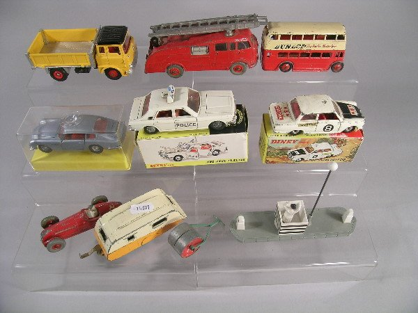 11B: A group of Dinky toys to include a boxed Aston Mar