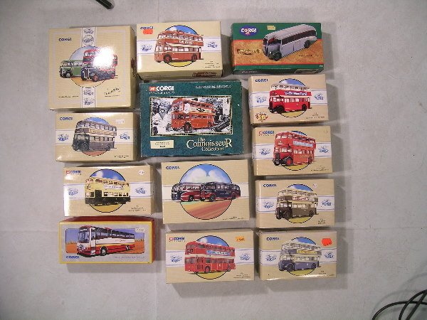 17B: A collection of fourteen Corgi buses of various ty