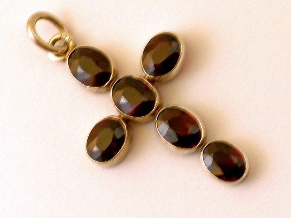 3:  A garnet set cross pendant, the six oval garnets co