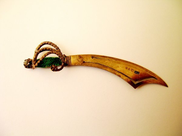 4:  A Charles Horner book mark in the form of a sabre,