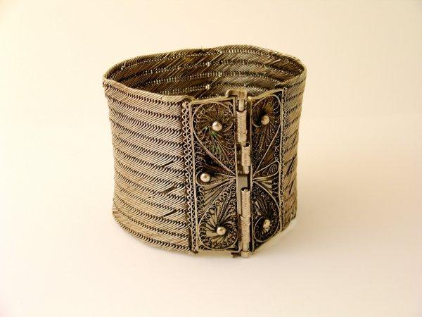 6:  An ethnic white metal cuff/bracelet, the clasp desi
