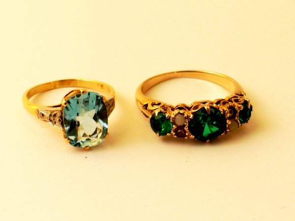 8:  A topaz and diamond set ring, all set in yellow and